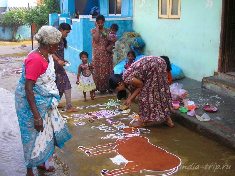 Ранголи в Индии иногда рисуется всей семьей